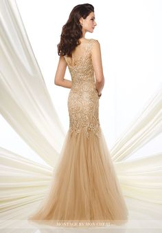 Metallic lace and tulle trumpet gown with slight cap sleeves, illusion bateau neckline, lace sweetheart bodice with dropped waist, illusion keyhole back, gathered soft tulle skirt with sweep train. Matching shawl included.