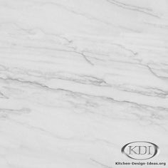 Classic White Quartzite, more durable than Carrara Marble. Need to check this out in person to judge the look. Is there a marble lover out there who's tried it?
