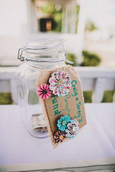 honeymoon fund jar  http://www.weddingchicks.com/2013/09/20/wedding-in-pink-and-gold/