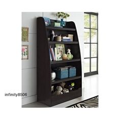 Keep a child's room or nursery neat and tidy with the help of this versatile bookcase. In a dark espresso or white finish, the bookcase features four open shelves plus a semi-enclosed compartment on the bottom to hold toys, games, sports equipment, books and more. Color: Espresso Dimensions: 60.00 inches high x 31.57 inches wide x 15.51 inches deep Includes: One (1) bookcase Four (4) open shelves hold toys, books and personal items Semi-enclosed compartment at the base Brand: Altra…