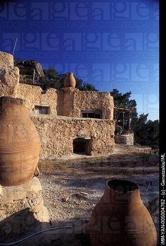 Terraces of the cottages,chimney-pots decoration Valley of Aspros Potamos, Ierapetra, Crete, Greece