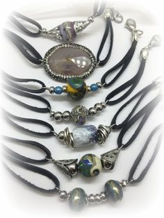Handmade Leather Beaded Bracelets & Necklaces. LAMPWORK GLASS BEADS, ALL STAINLESS STEEL COMPONENTS.