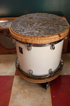 old drum converted into an end table. with salvaged wood from the DiXIE chiCKEN & locking casters.