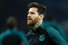 Lionel Messi of Barcelona looks on during the warm-up before the UEFA Champions League Round of 16 first leg match between Paris Saint-Germain and FC Barcelona at Parc des Princes on February 14, 2017 in Paris, France.