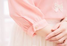 Ladylike Poise ~ sweet little bow on her blouse