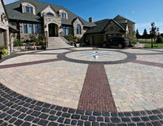 This driveway is a show stopper! Pavers used are Stonehenge, Courtstone and Copthorne by Unilock. Products can be purchased from Stone Gallery Landscape & Masonry Supply in Newton MA and can be delivered within a 50 mile radius. Brick Driveway, Driveway Design, Circular Driveway, Driveway Landscaping, Brick Pavers, Driveway Ideas, Concrete Patios, Concrete Patio Designs, Paver Designs