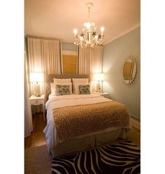 Colors: Orange-yellows, blue, white, black, white Design: patterned zebra rug, nice bedroom, gives off a comfy and welcoming feel, good for a guest bedroom