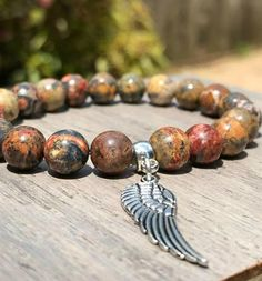 Angel Wing Leopard Jasper Bracelet Jasper Gemstone, Gemstone Beads, Angel Wing Bracelet, Beaded Jewelry, Beaded Bracelets, Clear Quartz Crystal, Angel Wings, Stones And Crystals, Jewelry Crafts