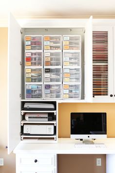 2 things I love about this craft room feature -- (1) great way to store all of the random paper scraps & bits that you get when you cut paper for scrapbooking. I always want to keep those bits for later, but needed a way to organize them so they're useful later! ...and (2) PULL-OUT TRAYS FOR PRINTERS/SCANNERS/PAPER CUTTERS! Ohmygosh. Heaven.
