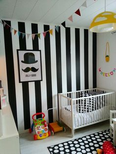 Monochrome graphic kids room nursery girls room. Striped black and white wall. cool nursery