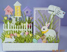 Easter or Spring Card. Side Step card. Dies used: Impression Obsession - Birdhouse set, Fence Trio, Grass, Grass Border, & Tulip set. Memory Box & Poppy Stamps - Bunny Buddies & Springtime Bunnies & Curbside Mailboxes. Punch used for Easter Eggs. Large bunny is a 3D cut I found at a Dollar Store. Handcrafted by Debbie Hill / April 2017