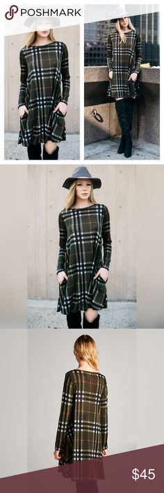 Plaid Sweater Shift Dress Fun Fall Plaid Sweater Dress with hidden pockets!                                                                        Colors: Olive, Black, White, and a small stripe of Red                                                                                          Sizes: S, M, L, and XL.                                                             Restock 9/9 Dresses Midi