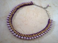 Statement crochet necklace with purple thread and purple beads .