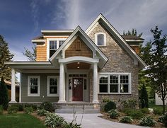Love the stone, shingles, and siding combined with white trim.
