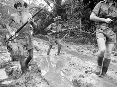 Australian troops plough through the mud at Milne Bay New Guinea shortly after the unsuccessful Japanese invasion attempt 1942.