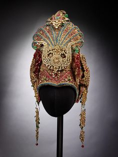 Theatre costume        Date:        mid 20th century (made)      Artist/Maker:        Unknown (production)      Materials and Techniques:        Silk, sequins, metal cord, paste jewels, gold metal braid, wire, beads, lined with velvet      Credit Line:        Given by the Trustees of the Ram Gopal Estate      Museum number:        S.112-2004