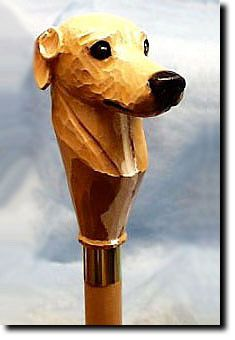 Greyhound Dog Walking Stick. The Greyhound Dog Walking Stick is a reproduction of an original woodcarving by Michael Park, a Master woodcarver, recognized worldwide for his detailed carvings and reproductions. Each walking stick is cast in resin and hand painted by master artists capturing a style of charm and warmth.
