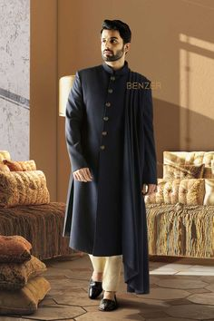 MIDNIGHT NAVY INDO SET The midnight navy blue kurta with a side drape in polywool. Coupled with beige churidar for a imperial look. Indian Groom Wear, Indian Wedding Wear, Wedding Dress Men, Wedding Suits, Sherwani Groom, Wedding Sherwani, Boys Kurta Design, Kurta Pajama Men, Couple Pajamas