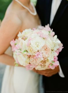 Pale, sophisticated pastel bouquet with white, peach, and pink roses | Vancouver Wedding Florist
