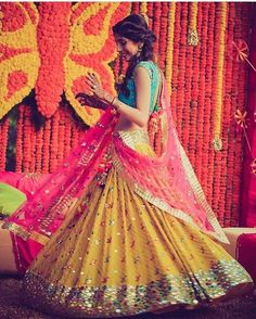 Looking for bright colorblocked lehenga in leheriya yellow pink and blue with mirror work detailing? Browse of latest bridal photos, lehenga & jewelry designs, decor ideas, etc. on WedMeGood Gallery. Indian Wedding Outfits, Bridal Outfits, Indian Outfits, Bridal Dresses, Eid Outfits, Eid Dresses, Mehendi Outfits, Family Outfits, Saris
