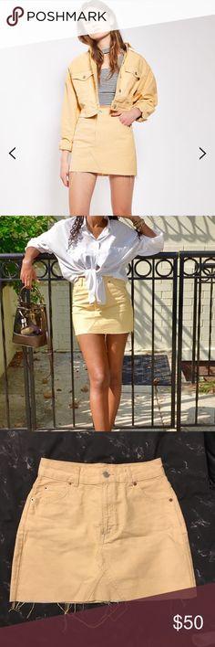Topshop yellow denim mini skirt Topshop yellow denim mini skirt. Frayed edges, super cute! Worn once in perfect condition. Topshop Skirts Mini