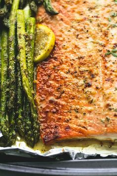 Flaky, perfectly baked lemon parmesan salmon & asparagus in foil is an easy and healthy 30 minute meal with fantastic flavor.