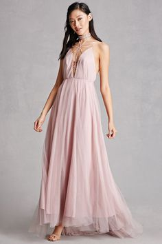 A woven maxi dress featuring a plunging neckline with a caged design and high-polish O-ring accents, cami straps, a caged back with high-polish O-ring accents, a tulle overlay, and an invisible back zipper. This is an independent brand and not a Forever 21 branded item.