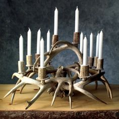 Whitetail antlers are artfully arranged into this spectacular Antler Candle Centerpiece. Imagine this on your holiday table with a few greens and maybe a few feathers tucked in. Antler Centerpiece, Candle Centerpieces, Candles, Deer Antler Crafts, Antler Art, Country Decor, Rustic Decor, Farmhouse Decor, Deer Horns