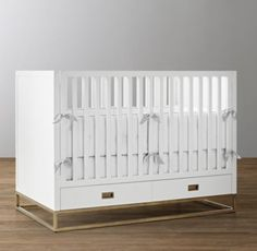 RH Baby & Child's Avalon Panel Storage Crib:The sleek lines of our collection capture the sophisticated restraint of modernism, while its polished cast-metal fittings take it in a new direction.