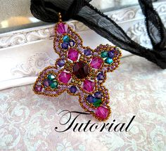 Mystère Beading tutorial.Pattern.Exclusive.PDF file containing instructions for making the Crystal Cross Pendant, not the pendant itself.