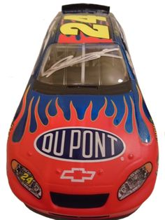 This is a Jeff Gordon signed Dupont #24 AP Action 1:24 scale diecast race car. Jeff signed the car in silver sharpie on the windshield. Check out the photo of Jeff signing for us. ** Proof photo is in