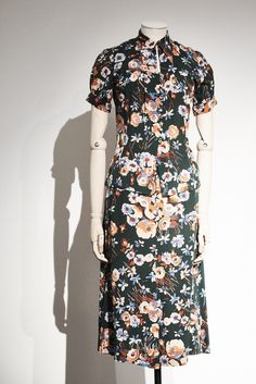 Inside Chloé's Guy Bourdain Exhibition In Paris: Chloé has unveiled its new space. Click through the gallery below to check out the space and the two exhibitions at Maison Chloé. -- Floral Midi Dress  |  coveteur.com