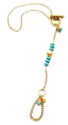 Fitrou Summer 2012 Ankle / Foot Jewelry by Tanya Paradis for FITROU. Gold, Turquoise chain jewelry.