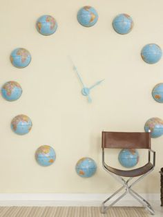 globes repurposed as oversized wall clock