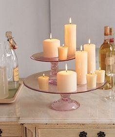 Cake Stand as Candle Holder Create a candle centerpiece to light up your wedding (or you dinner table) by using cake stands as platforms for votive and pillar candles in assorted sizes. More New Uses: kitchen items, entertaining, weddings, baking New Uses, Real Simple, Cake Plates, Kitchen Items, Pillar Candles, Flameless Candles, Beeswax Candles, Candle Holders, Candle Stand
