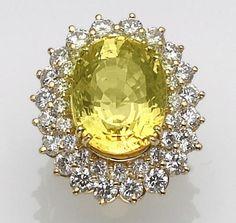 A yellow sapphire, diamond and eighteen karat gold ring, Élan.