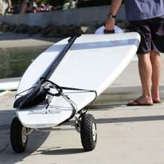 What is the best way to transport your SUP? We compare the best SUP carriers and car racks and tested some of the popular options. Make sure you avoid a few basic mistakes and get a free. Sup Stand Up Paddle, Sup Paddle, Sup Surf, Sup Fishing, Sup Accessories, Kayak Storage, Storage Cart, Sup Boards, Sup Yoga