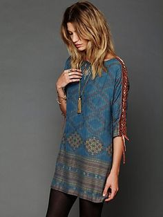 absolutely adore this 'New Romantics Stole My Heart' tunic by Free People. Paired with tights and a bronze tassel pendant for a cool boho style.