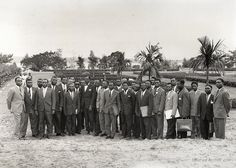June 24, 1960 - Lumumba's first government on Parliament grounds. Lumumba center left in bow tie, Mobutu 5th from right in sun glasses.