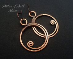 Handmade copper earrings. Solid copper wire was used to form these earrings. The ear wires are also solid copper. They were hammered for