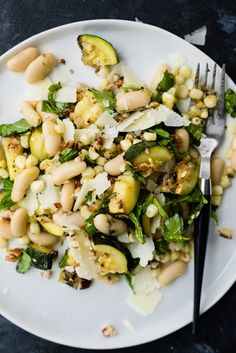 A little sweet, a little smokey, a little crunchy - this grilled zucchini salad with corn and marinated white beans has all the tasty flavors of summer! It's substantial enough for lunch or dinner on Clean Eating Snacks, Healthy Eating, Picnic Side Dishes, Cooking Recipes, Healthy Recipes, Veg Recipes, Warm Salad Recipes, Cooking Ideas, Arugula Recipes