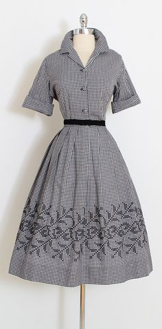 ➳ vintage 1950s dress * black & white gingham cotton * embroidered skirt design * button front * cuffed sleeves condition | excellent fits like xl length 44 bodice 17 bust 42-44 waist 34 shoulders 17 sleeves 11 hem allowance 3 ➳ shop http://www.etsy.com/shop/millstreetvintage?ref=si_shop ➳ shop policies http://www.etsy.com/shop/millstreetvintage/policy twitter | MillStVintage facebook | millstreetvintage instagram | millstreetvintag...