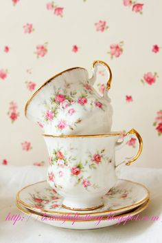 Beautiful set of tea cups and saucers, white with tiny pink roses and gold trim...<3