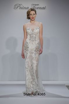 High neck illusion Chantilly lace gown accented with Swarovski crystals