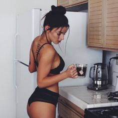Women Nude in the Kitchen