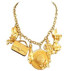 Chanel Gold Plated Charm Necklace w/6 Charms | From a unique collection of vintage jewelry at https://www.1stdibs.com/jewelry/