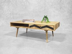 The mid century coffee table designed for versatility with uncompromising style and charm.