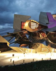 Not only are the titanium swoops a Frank Gehry signature but they allude to wine glugging out of a bottle, an homage to the area's winemaking heritage.  La Rioja, Spain