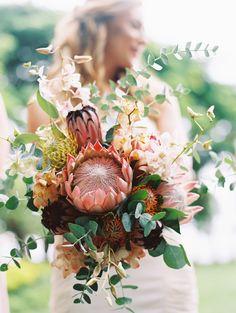 Hawaiian beauty | Photography: Wendy Laurel - www.wendylaurel.com  Read More: http://www.stylemepretty.com/destination-weddings/2015/03/11/diy-maui-wedding-at-olowalu-plantation-house/