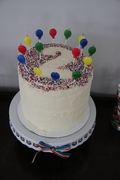 Place a cut out number on the cake with paper/cardboard & sprinkle around it...